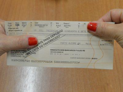 Sindicato entrega cheques de ação de integração de gratificação semestral no 13º contra o Bradesco, a partir de terça, 26/6