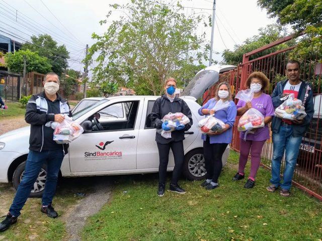 SindBancários leva alimentos e solidariedade à 50 famílias da Hí...